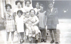 Isabel's Omi, Margot, at age 2 sitting on her aunt's lap, surrounded by family who perished.