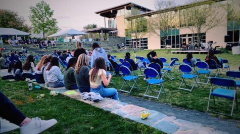 Upper schoolers enjoying student performances from the quad at Coffeehouse
