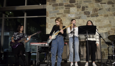 Natalie, Isabel, and Alejandra (senior members of the Coffeehouse Committee) performing in 2019.