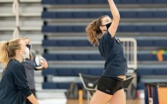 Charlotte Castle '23 and Tess Weinreich '21 playing volleyball in the abbreviated fall sports season this spring.